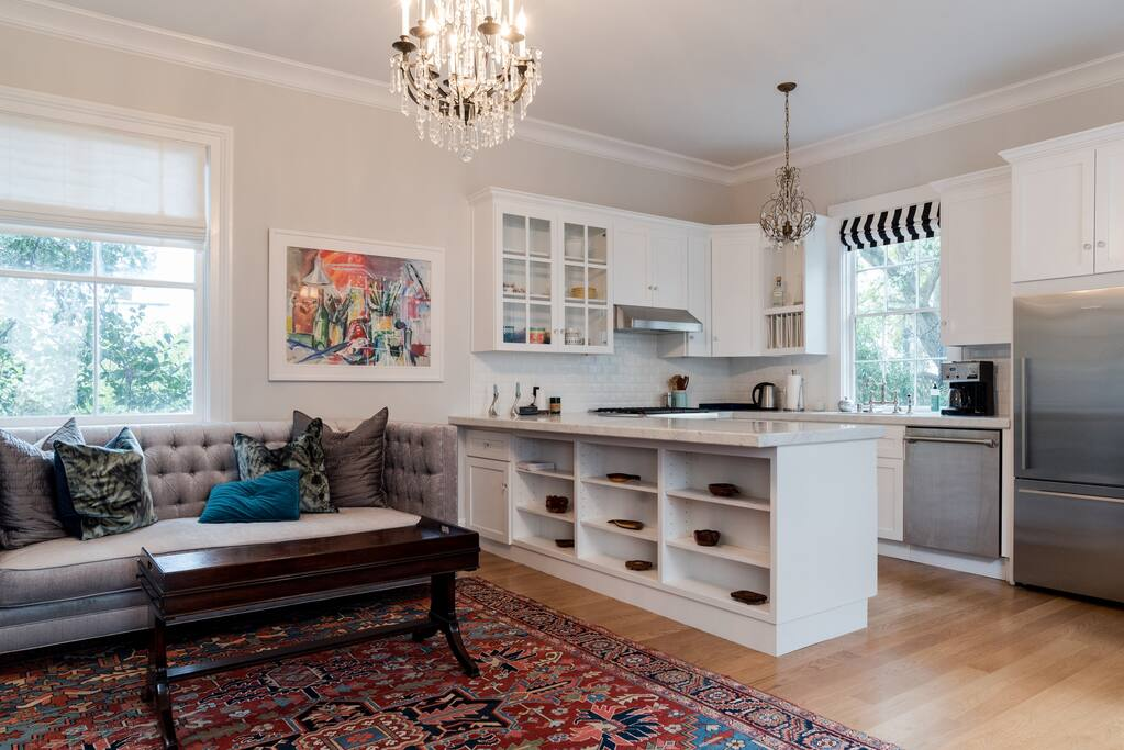 Living space with full kitchen and queen pull out bed