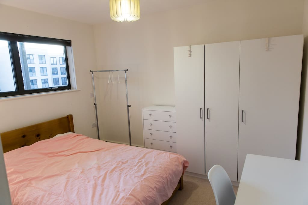 the room with double bed & desk