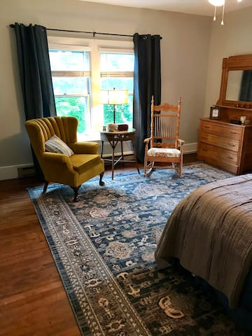 Second bedroom (Gold Room) on 2nd floor with a queen bed. Has an in-window AC unit.