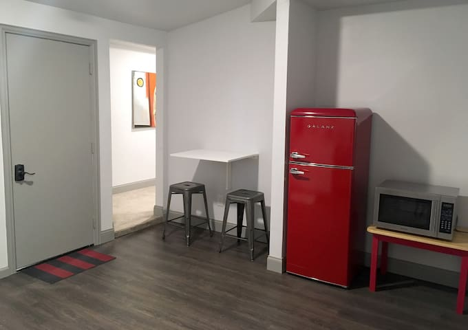 Kitchen continued with retro fridge and eating area.