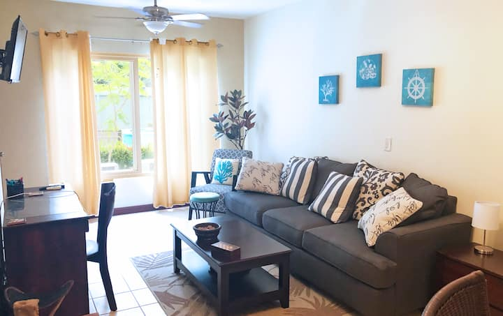 Tropical condo with pool! 5 minute walk to beach!