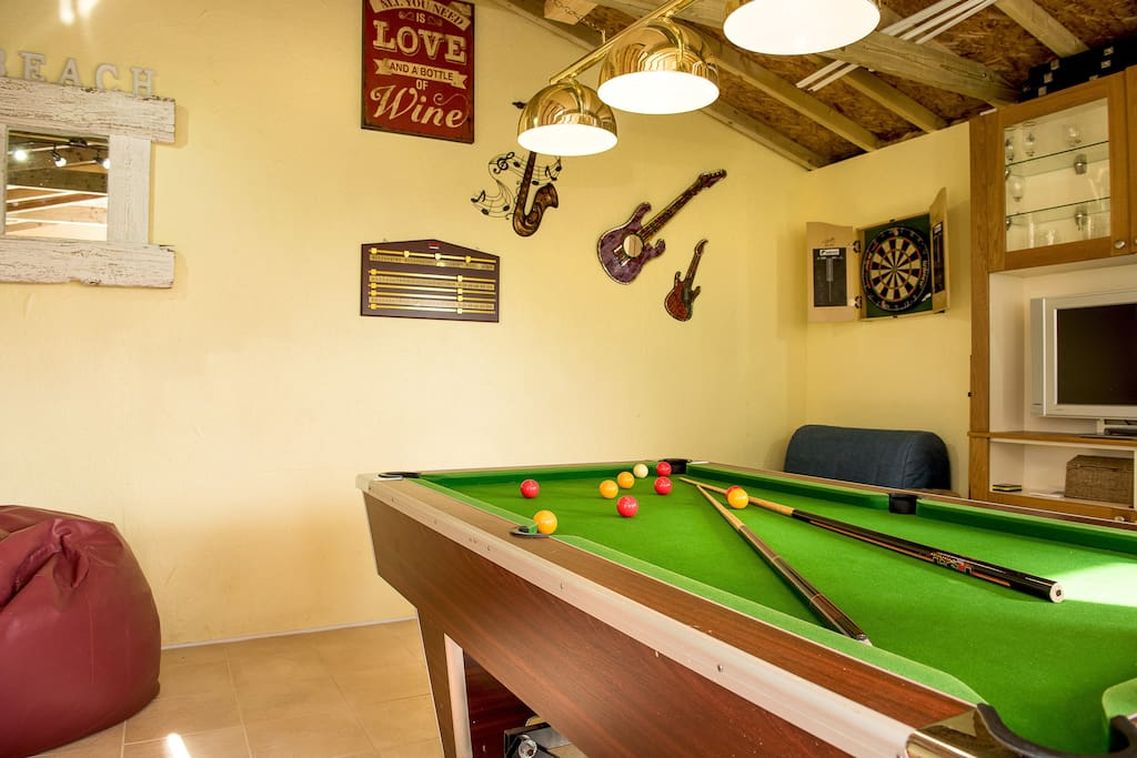 Pool Room with dartboard and TV