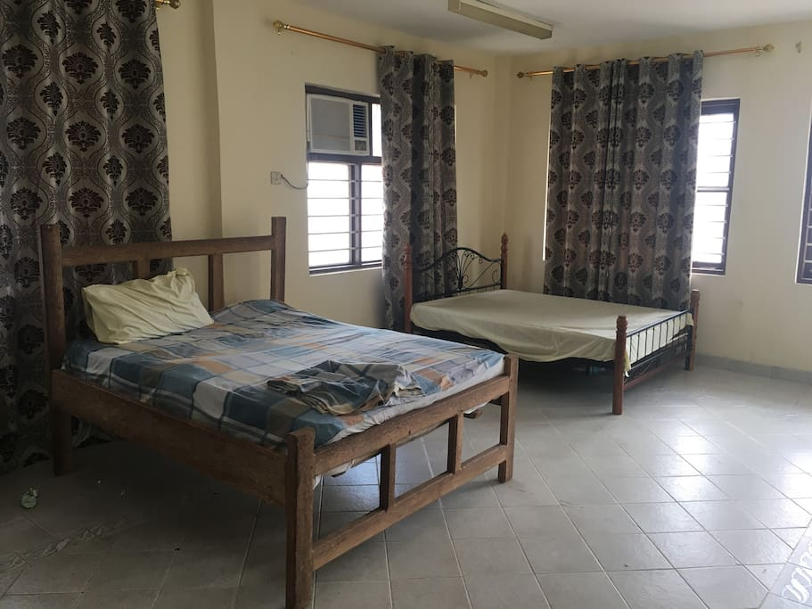 Two beds,pretty ideal for back packers,short/long staying tourists ac working and very spacious.