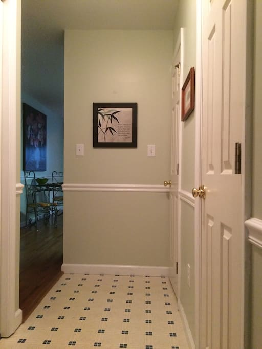 Mudroom. Laundry to the left, half bath and pantry to the right.