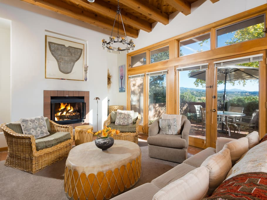 Alternate view of living room showcasing french doors and lots of natural light