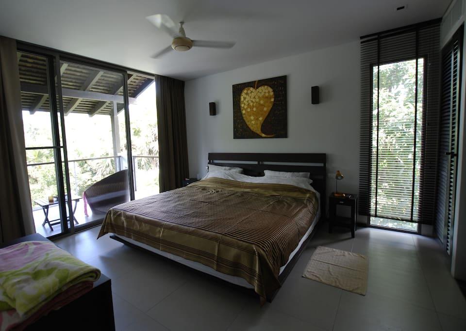 Master bedroom with sliding door to balcony