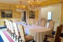 Formal dining room seats 12 as pictured and can seat more.