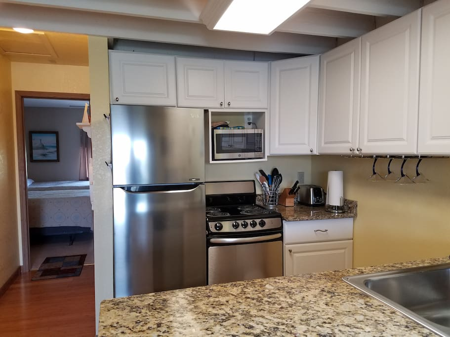 The refrigerator and electric stove are new.