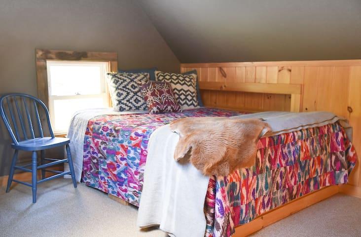 Queen bed in loft bedroom