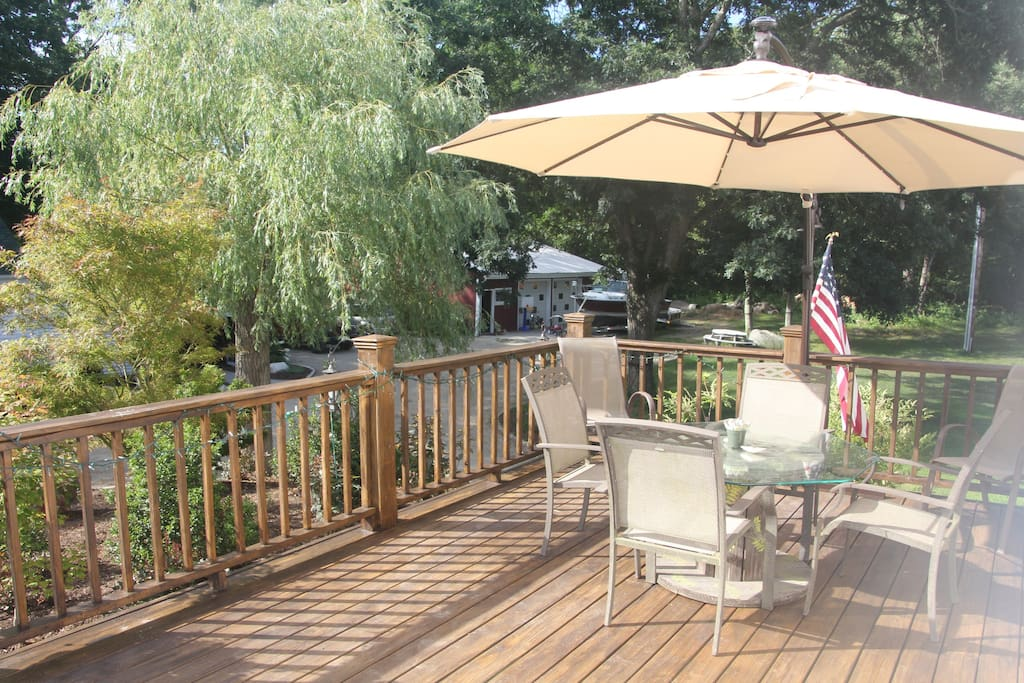 Shaded deck with gas grill.