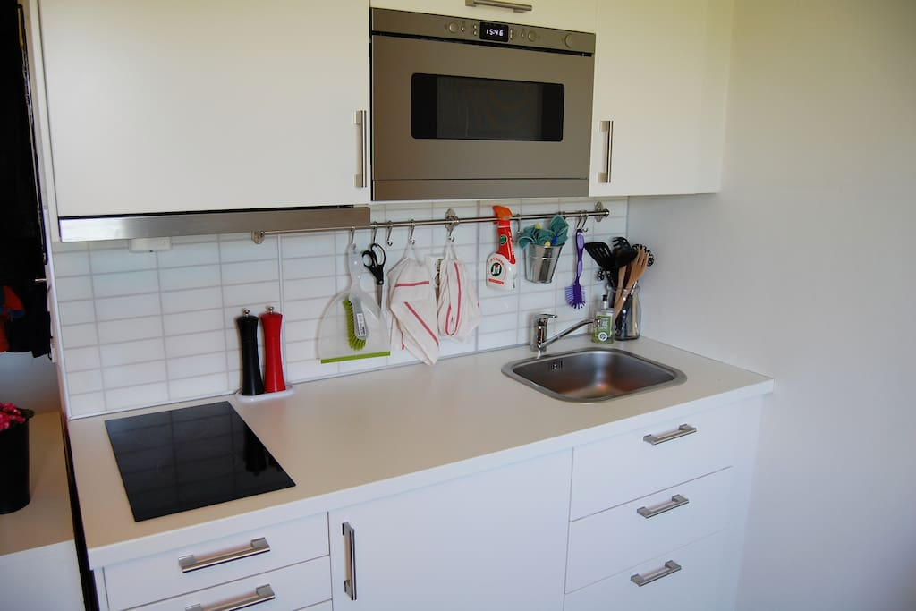 Kitchen with refrigerator, microwave and a Nespresso Coffee maker