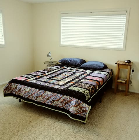 Private room with queen-sized bed, study desk, lots of closet space, and built-in study desk.