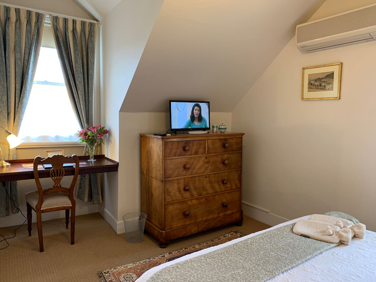 Upstairs Queen Suite with separate sitting room with sofa bed, accommodates three adults.