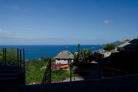 Quaint island studio overlooking dazzling ocean