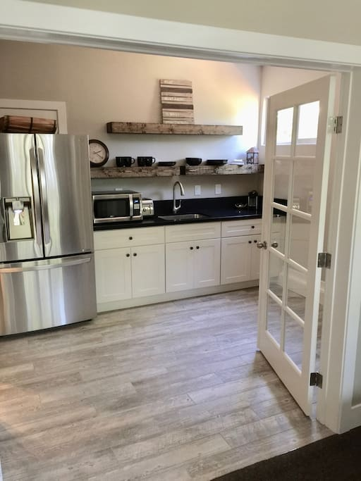 Enjoy complimentary coffee in large kitchen w french doors, slate counter tops and all new appliances including a full refrigerator w filtered water
