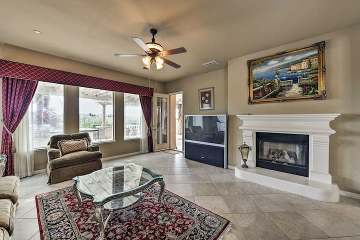 The 60-inch living room is complete with a flat-screen TV and gas fireplace.