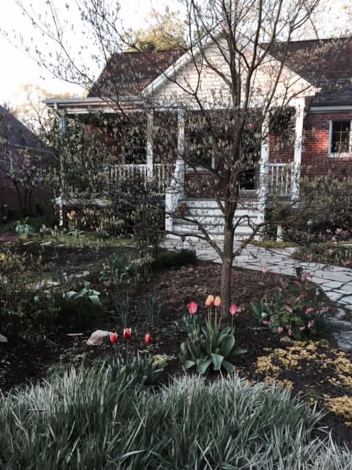 Beautiful yard w/cozy front porch perfect for breakfast/coffee/ reading