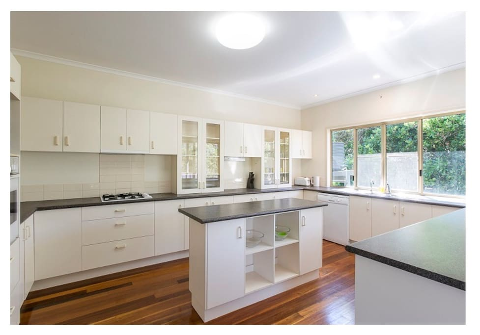 Huge family kitchen with dishwasher, microwave, cooktop, oven and most importantly, a coffee maker - Aldi brand for coffee pods.