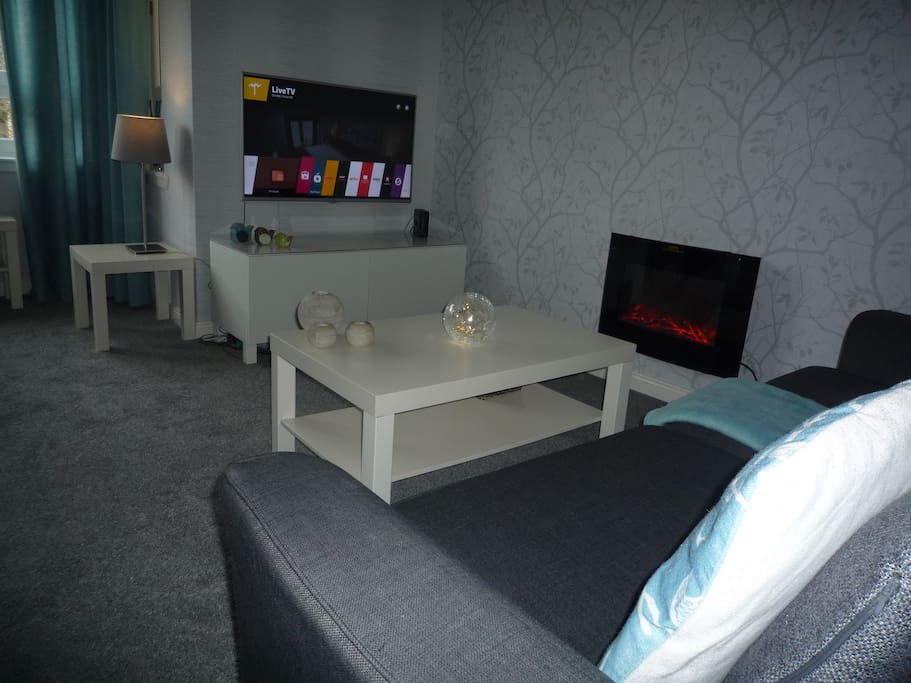 Spacious Lounge with fireplace + Smart 43 inch TV offering Netflix, Now TV & HD Freeview
