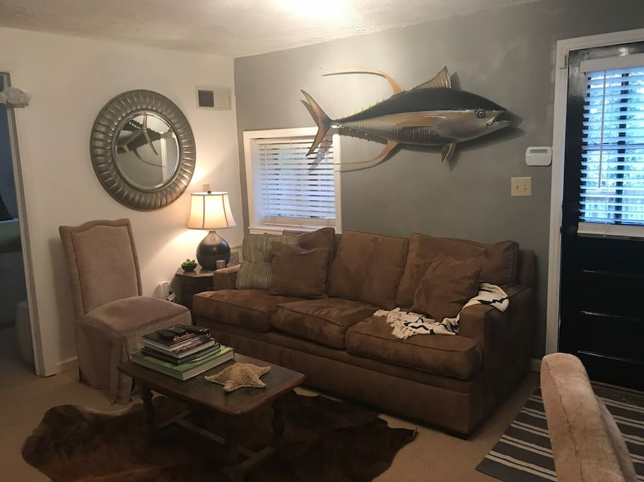 Living area - queen size sofa bed. Large 4K smart tv is across from sofa. Twin air mattress is also available.