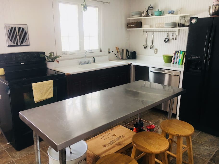 Clean, bright, functional kitchen.