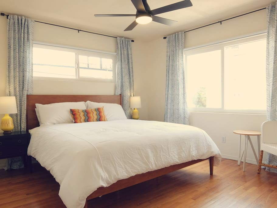 Bedroom 1 of 3 with comfortable king bed and tons of closet space. All of our bedrooms have blackout curtains to ensure a great night's sleep.