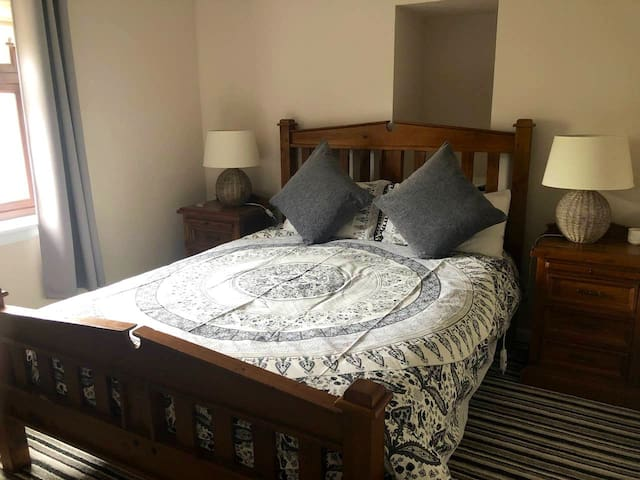 Double bedroom 1 with fitted wardrobe, chest of drawers and tv with Sky
