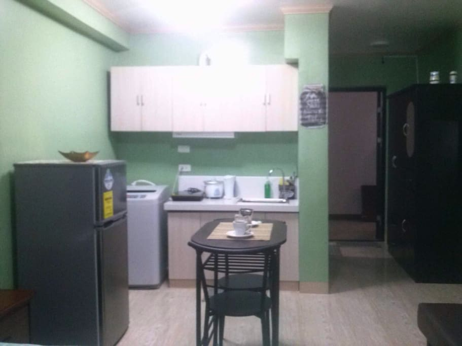 You can cook and wash clothes! With microwave, induction oven and good size refrigerator