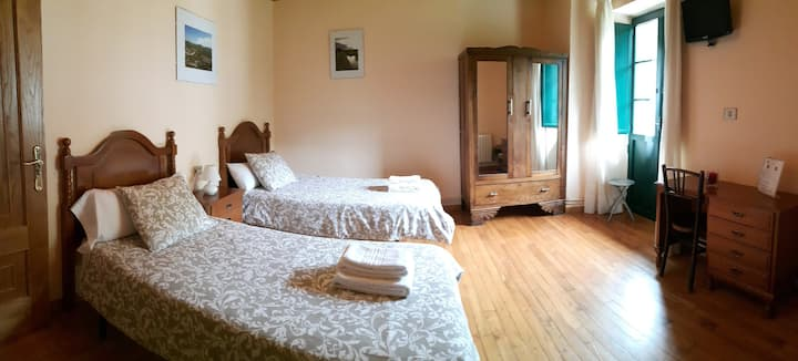 Twin room with private bathroom and a balcony