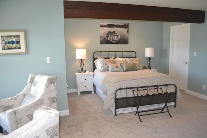 Huge master suite with two large closets and seating area.