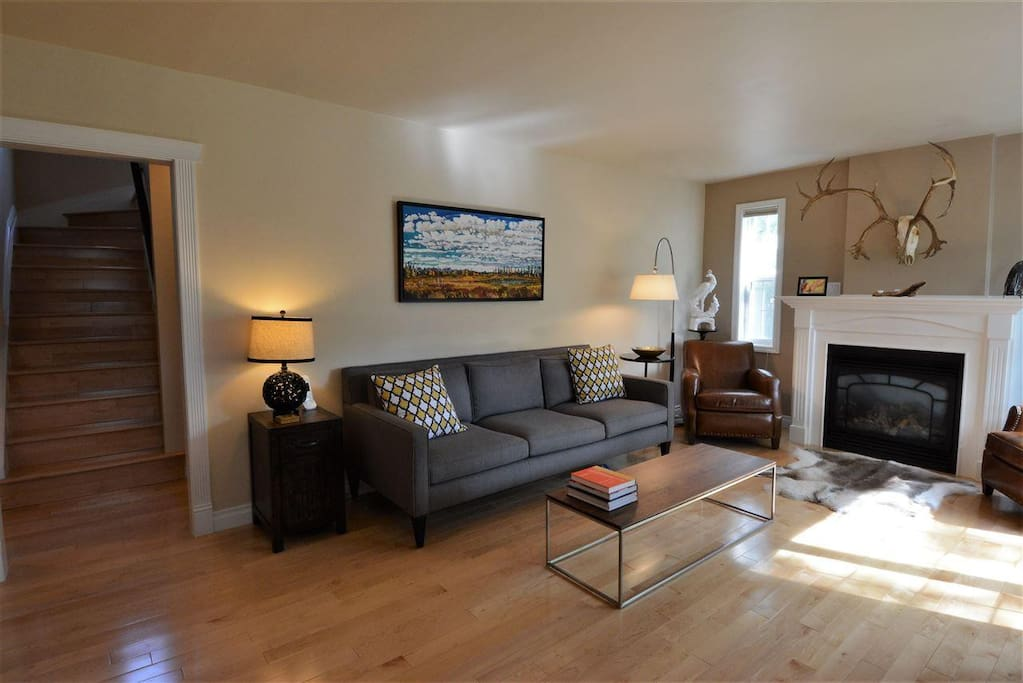 A bright and spacious living room with cozy gas fireplace.