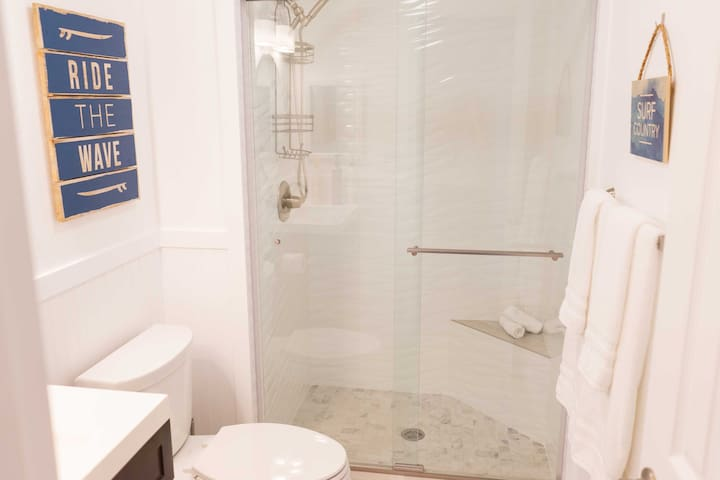 Rinse off any leftover sunscreen in the walk-in shower.