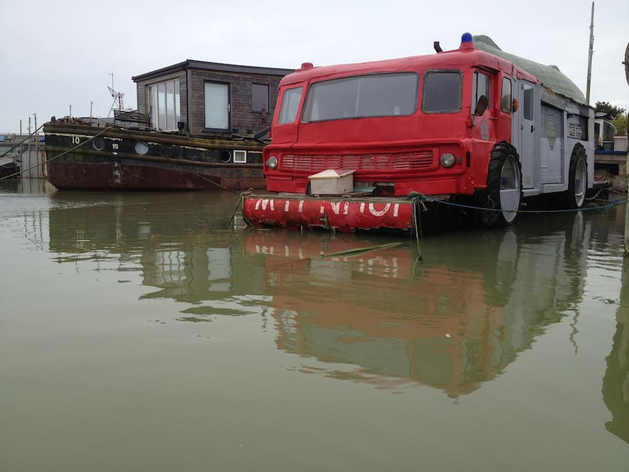 Dodge fire engine houseboat viewed from the river