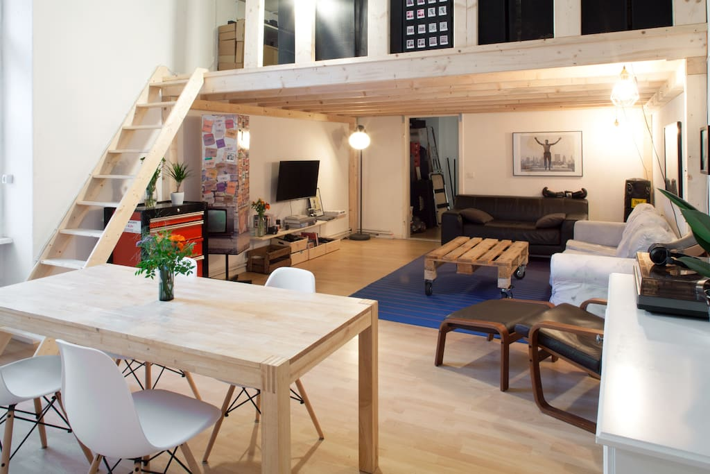 The common area is 40m2, includes a dining table, vinyl player, 2 sofas, a large TV. There is an additional bed above in the wooden mezannine. Feel at home!