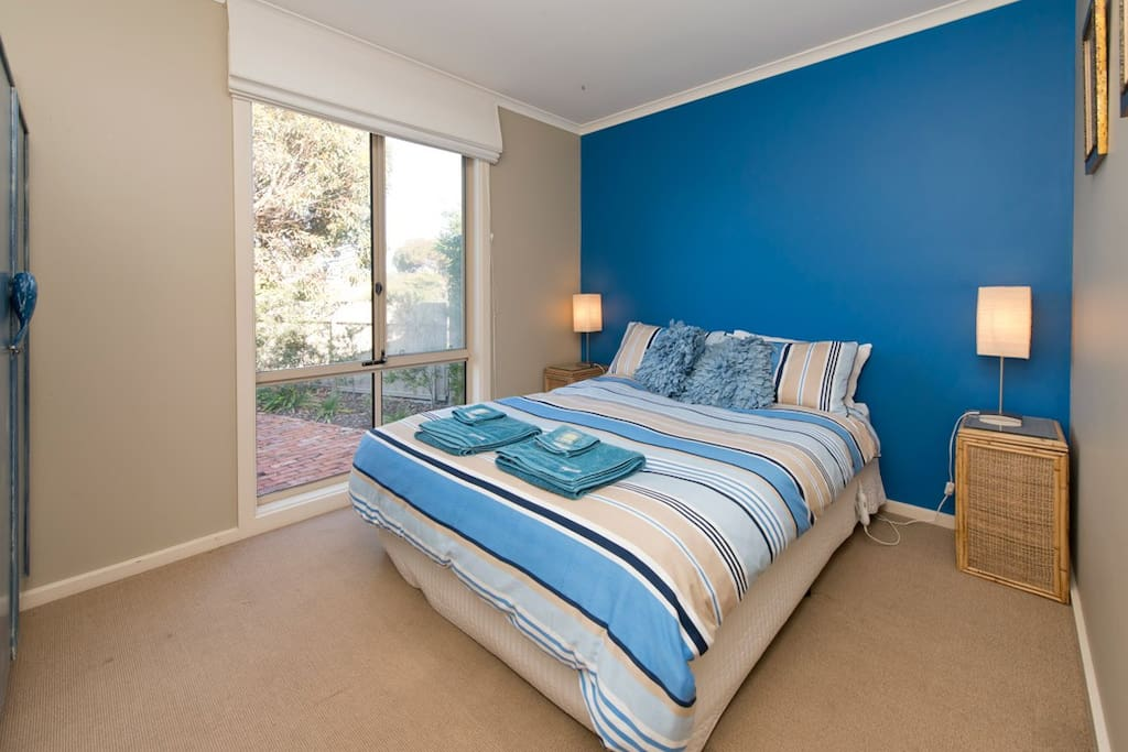 Spacious main bedroom, looking out to gardens