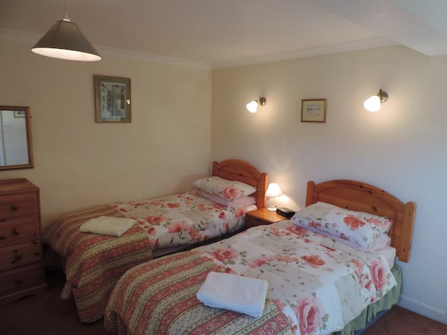 Twin bedroom can be king size and take an extra single bed.