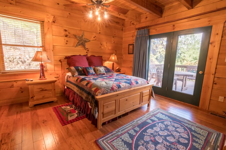 Four bedrooms total, including this main floor suite with full private bath.
