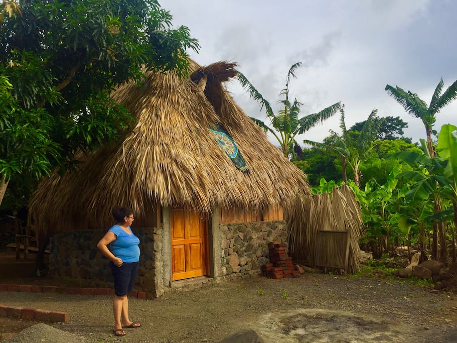The second cabin has a palm thatched roof and is two floor.