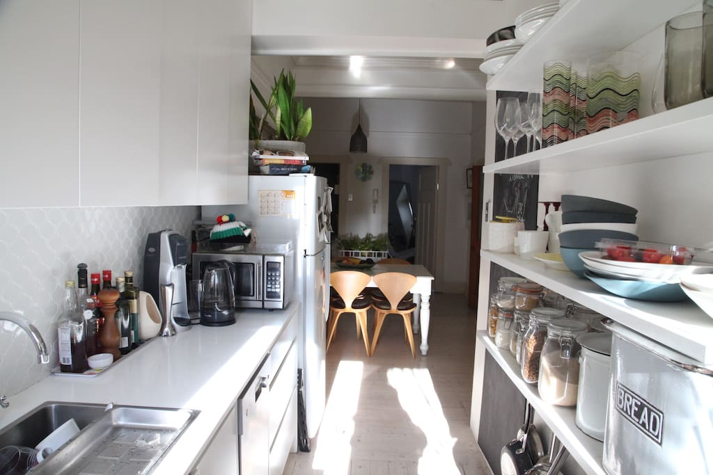 Kitchen through to dining and bedroom