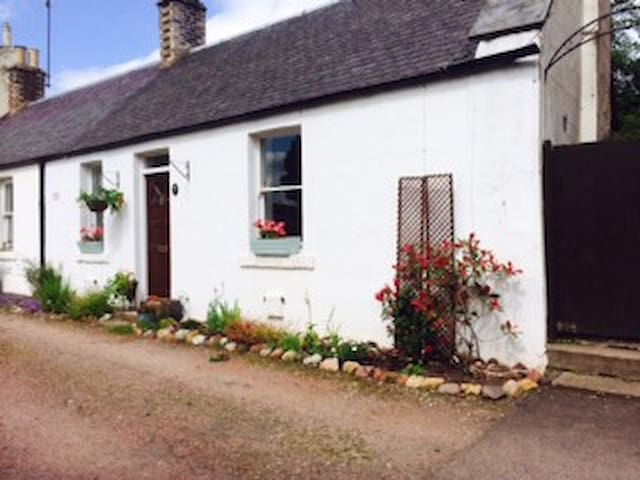 The front of the cottage, with parking just outside.