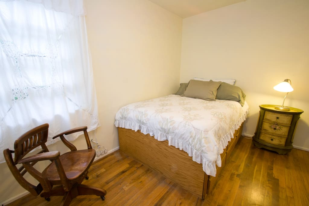 Very cozy Bedroom with lots of light and sea breezes, a full size bed, walk in closet, reading lamp, etc.