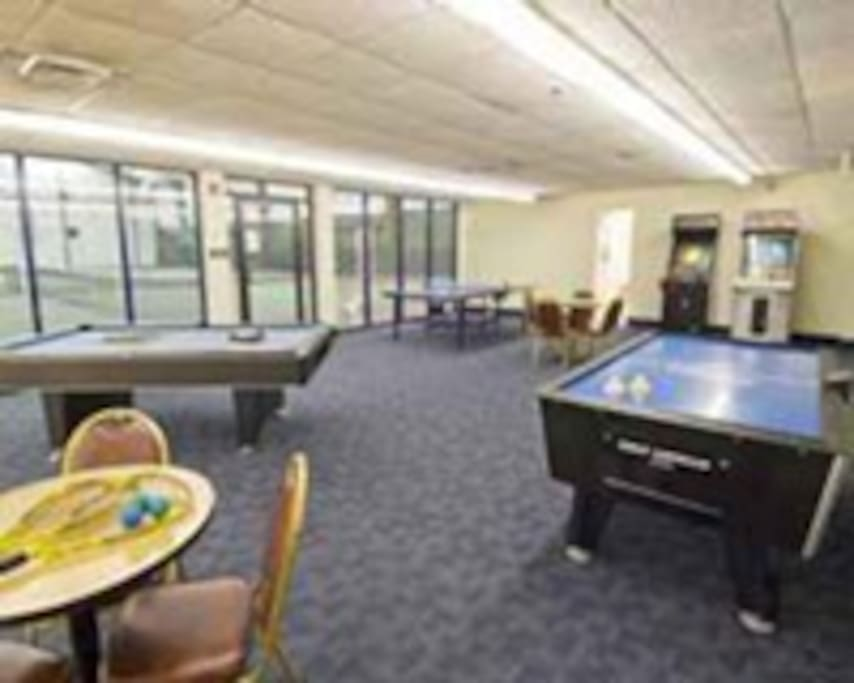 game room- indoor tennis thru glass wall on left