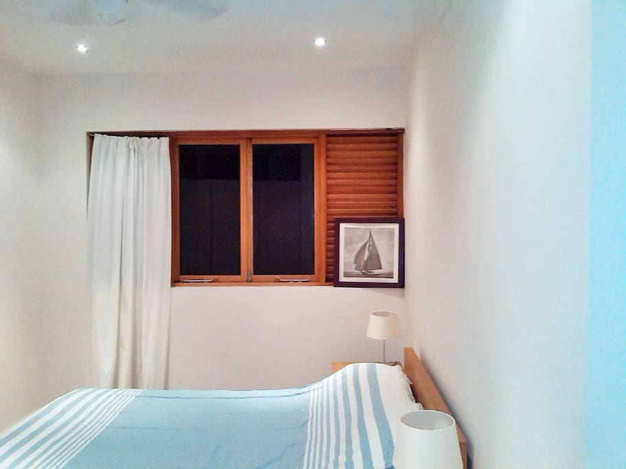Second bedroom- queen size bed with en-suite shower, safe and ceiling fans