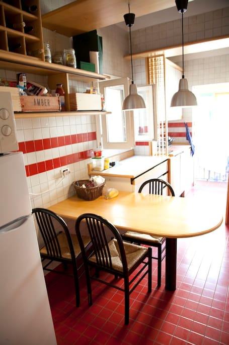 sunny kitchen with balcony