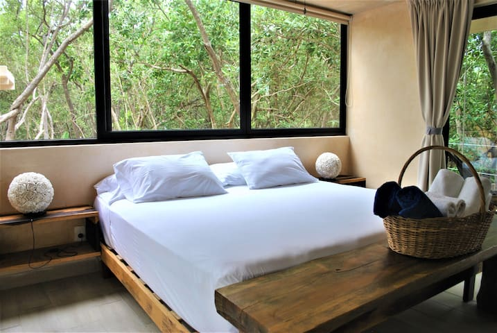 SUNSET Jungle Suites room, STEPS FROM THE BEACH
