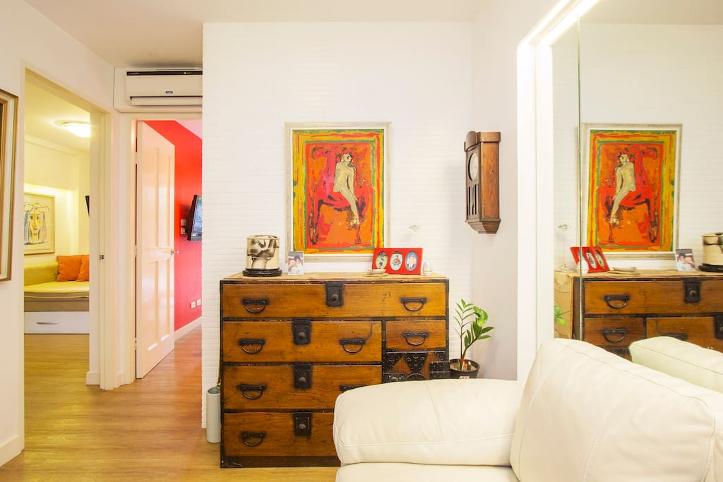 Living area, antique Korean chest, accentuated with art and Japanese wall clock...
