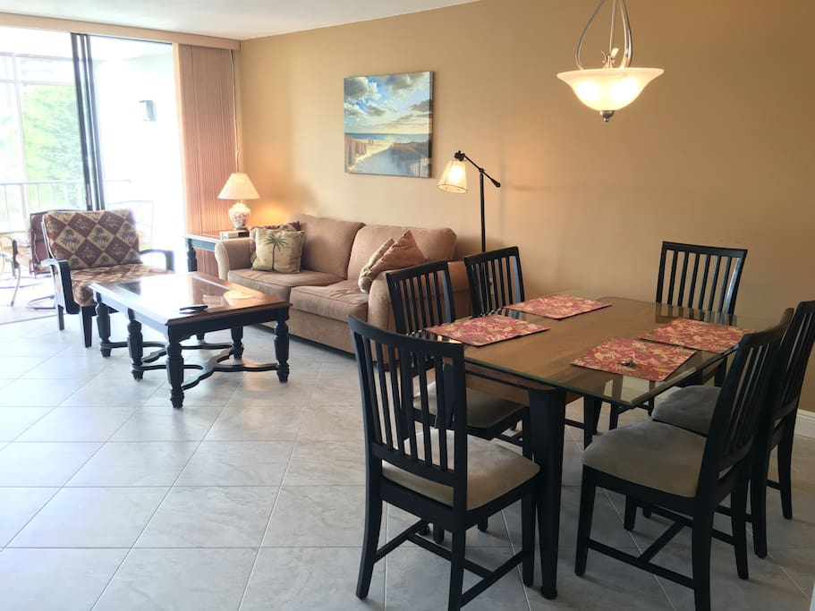 Open dining room and living room extend right to patio through sliding door
