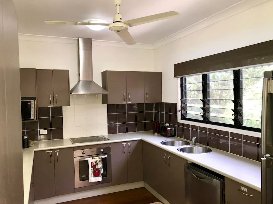 Large kitchen with everything you need to cook meals.