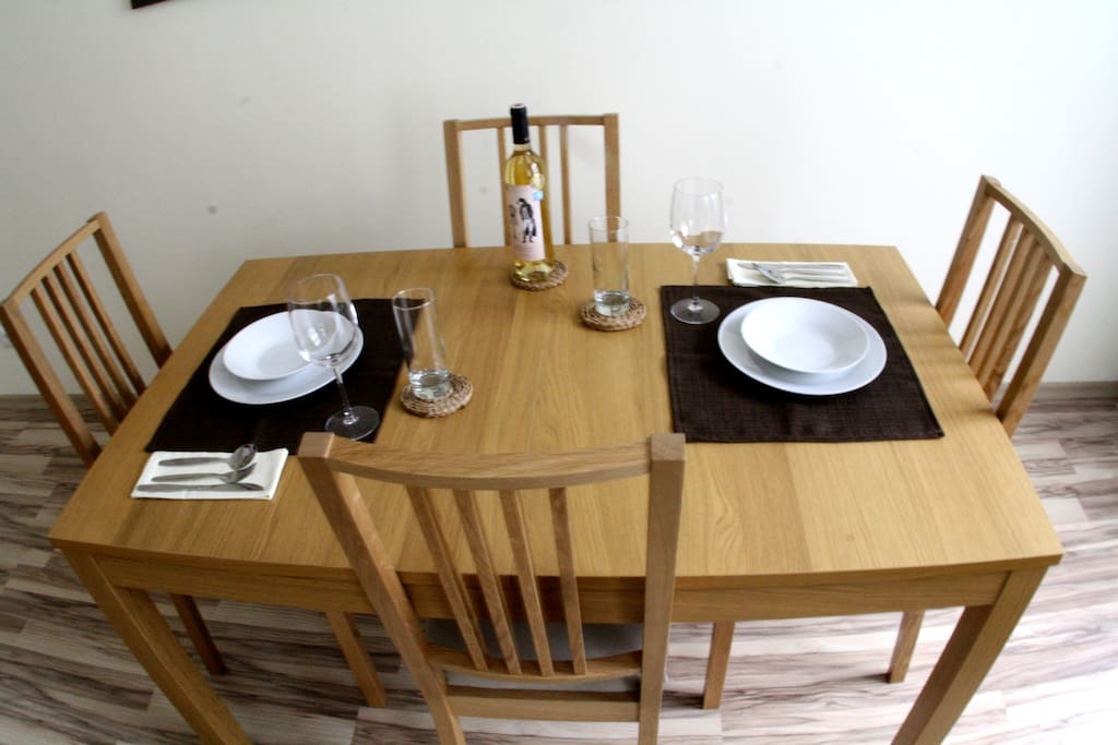 Nice dining table and chairs for four persons