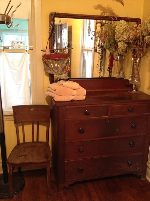 Another view in the room, with antique dresser and mirror.